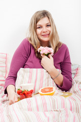 Pleased woman with romantic breakfast