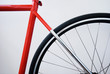 Red bicycle on whitebackground