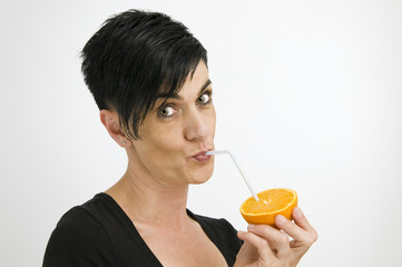suck on a straw with orange