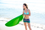 Surf girl with surfboard in beach shore