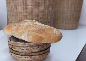 Bread baton in bamboo basket