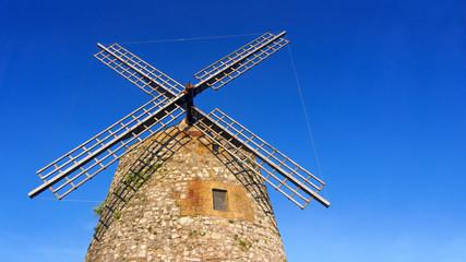 windmill in spain against blue sky
