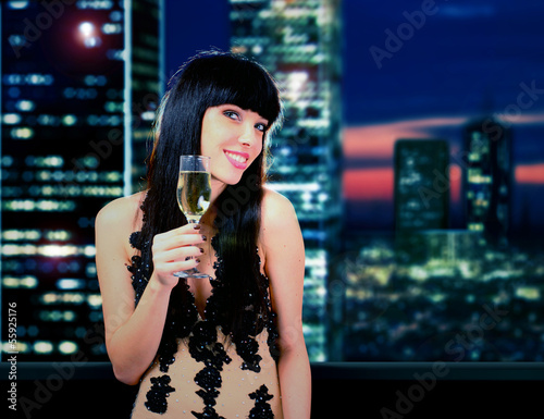 Happy woman with champagne glass