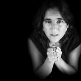 Black and white portrait of an hispanic woman praying