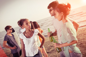 Group of Friends Having a Party at Beach..