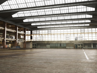 Large Interior grunge framed warehouse with an empty floor .