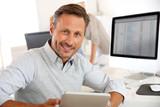 Fototapety Salesman in office using digital tablet