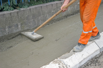 Worker leveling fresh Concrete