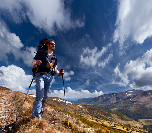 sportive man on the mountain trek