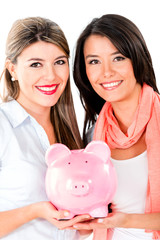 Women keeping savings in a piggybank