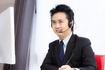smiling business man working with desktop computer