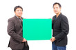 business man holding blank green board
