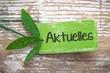Aktuelles Plakette in grüner Farbe