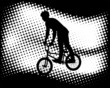 bmx cyclist on the abstract halftone background - vector
