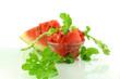 cut watermelon with plant part