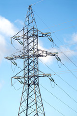 High-voltage power line metal tower prop over blue sky