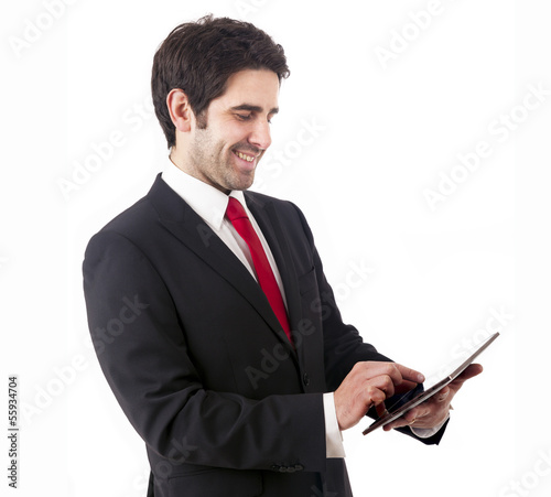 Handsome smiling businessman with tablet computer. Isolated over
