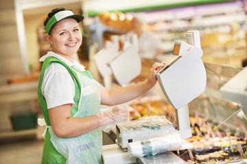 saleswoman in supermarket shop