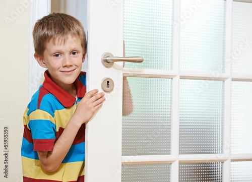 Boy opening door