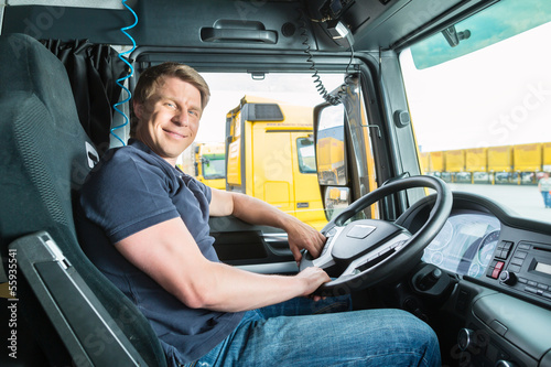 Forwarder or truck driver in drivers cap - 55935541