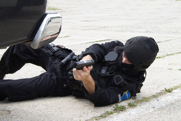 policeman lying on the ground