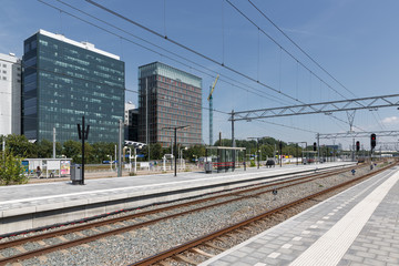 Railway station with office buildings in Amsterdam