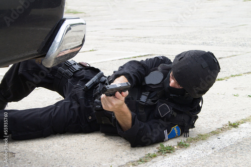 policeman lying on the ground