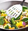vegetarian wok stir fry with metal spatula.