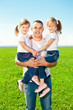 Happy family together in outdoor park  at sunny day. Dad and two