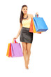 Beautiful woman walking with shopping bags