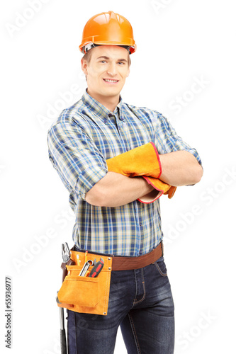 Confident and smiling manual worker with helmet posing