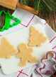 Cutting gingerbread cookies dough homemade for Christmas. Select