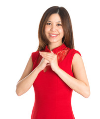 Asian woman respecting on Chinese New Year Festival.