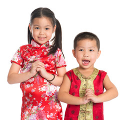 Little oriental children wishing you a happy Chinese New Year