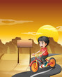 A boy biking at the desert with an empty signboard