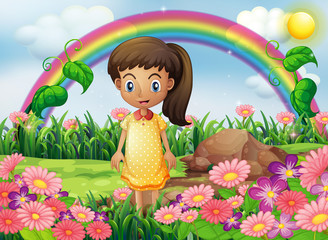 A girl in the garden with a rainbow at the back