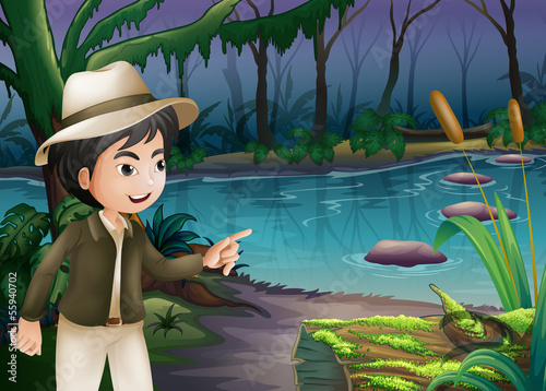 A young boy pointing the log with algae