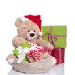 Teddybär als Weihnachtsmann isoliert mit Geschenke