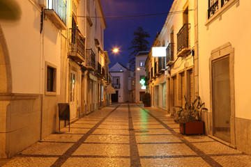 Narrow street in the old town of Tavira, Portugal