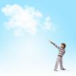 Cute boy catching clouds
