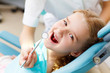 Little girl visiting dentist - 55943783