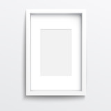 White  vertical frame on gray wall.