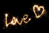Inscription Love and heart of sparklers.