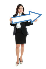 smiling businesswoman with direction arrow sign