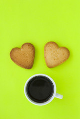 Cup of coffee and cookies in the form of heart.
