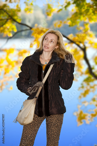 The beautiful woman in autumn park