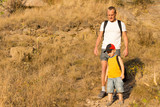 Father hiking with his small son poster
