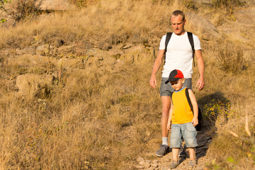 Father hiking with his small son
