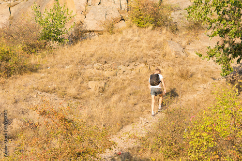 Solitary man hiking on a mountain path
