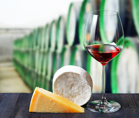 Glass of wine and cheese in winery